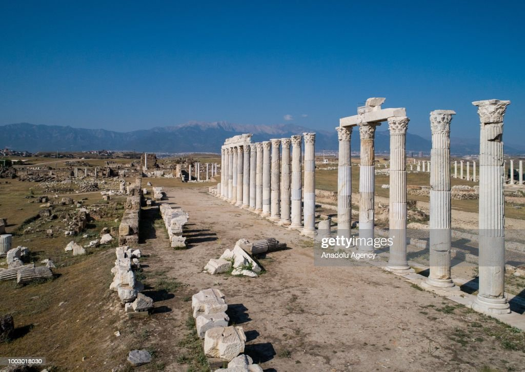 A view of the columns at Laodicea Ancient City in 6 kilometers north of Turkey's Denizli on July 19, 2018. Ancient city was constructed by Antiochus II Theos of Seleucid Empire for his wife during the Helenistic period in mid 3 B.C. City includes Christianity's one of first seven churches. City became a religious center as it reach a level of metropolis in the early Byzantine period. Laodicea's significant structures follow 285 meter long and 70 meter wide Anatolia's biggest stadium, two theatres, four bathhouse complexes, five agoras, five nymphaeums, two monumental entrance gates, Bouleuterion temples, peristyle houses, latrina, churches and monumental streets.