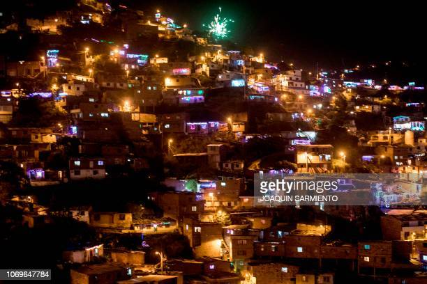 A view of the Comuna 13 on the Day of the Little Candles in Medellin Colombia on December 7 2018 The Day of the Little Candles is a traditional...