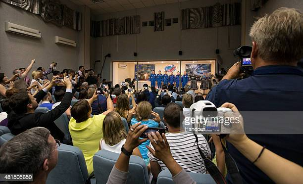 A view of the conclusion of the press conference held following a State Commission meeting to approve the Soyuz launch of the crew of Expedition 44...