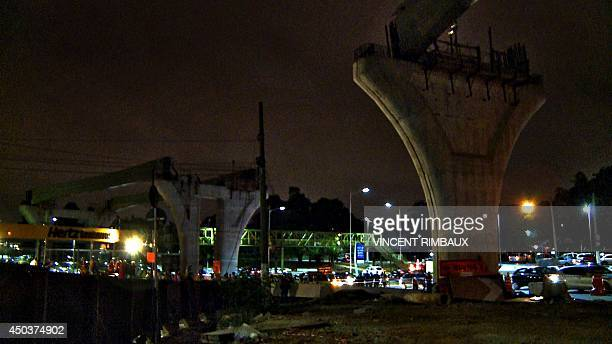 View of the concrete bases of an unfinished monorail after a concrete slab slipped and dragged a worker killing him and leaving two other injured in...