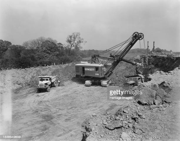 View of the construction of the Birmingham to Preston Motorway , showing a 110 Ruston Bucyrus diesel/electric excavator carrying out the excavation...