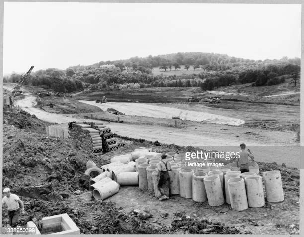 View of the construction of the Birmingham to Preston Motorway , looking south-west at Walton's Wood near Madeley Heath and showing workers standing...