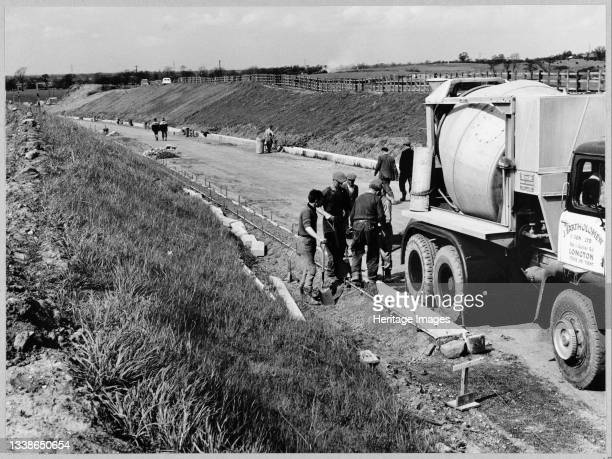 View of the construction of the Birmingham to Preston Motorway , looking north along a slip road on the east side of Section D of the motorway and...