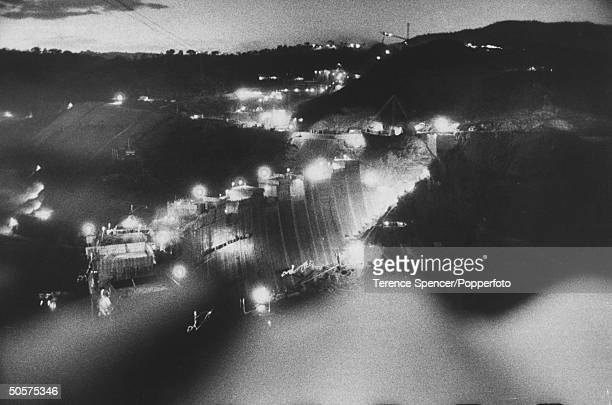 View of the construction of the Kariba Dam at night.