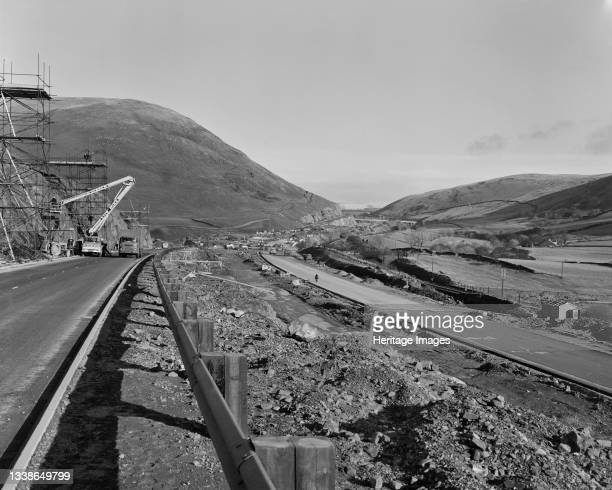 View of the construction of the M6 Motorway through the Lune Gorge, looking north along a stepped part of the motorway towards Low Borrowbridge. The...