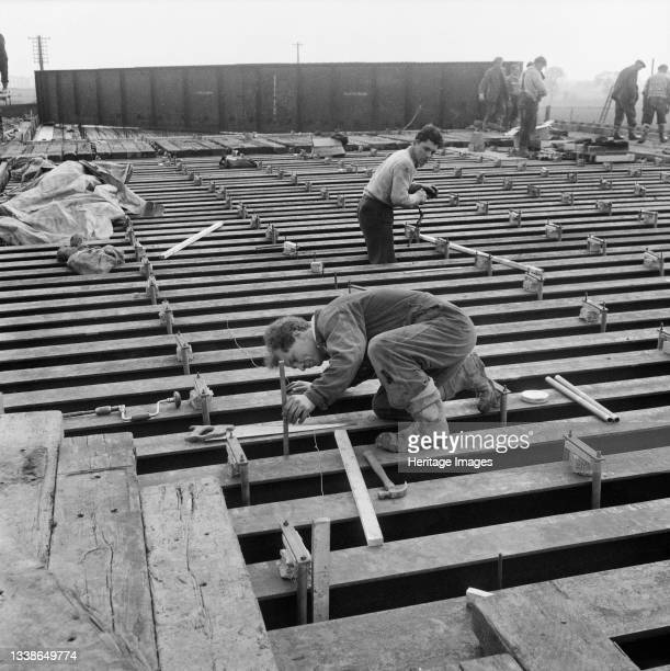 View of the construction of the Stafford/Wolverhampton railway bridge on Section A of the Birmingham to Preston Motorway , showing a team of workers...