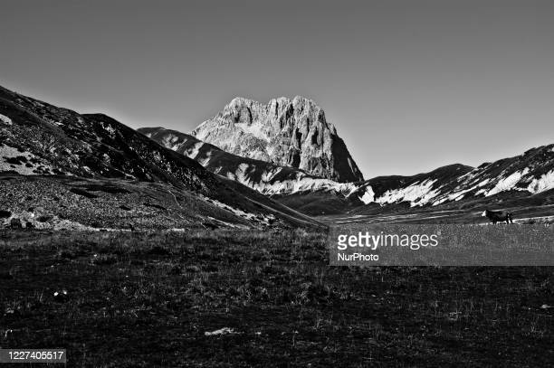 Image was converted to black and white) View of the Corno Grande, eastern peak, in the Gran Sasso National Park, in Abruzzo Italy, 15 July 2020.