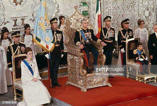 View of the coronation of Mohammad Reza Pahlavi as Shah of Iran with Queen Farah Pahlavi on left and Reza Pahlavi Crown Prince of Iran on right in...