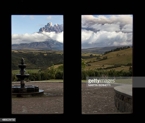 View of the Cotopaxi volcano spewing ashes from a hotel in Sangolqui Ecuador on August 23 2015 A dozen towns of central Ecuador including Quito...