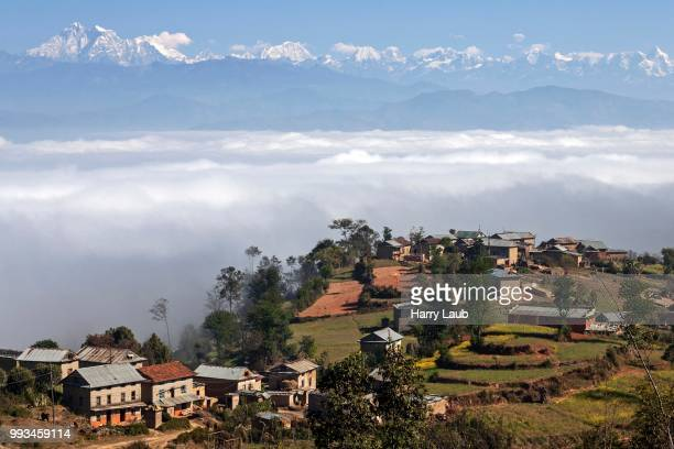 View of the countryside, rural houses, terraced fields and mountains of the Himalayas, fog in the valley, near Dhulikel, Nepal