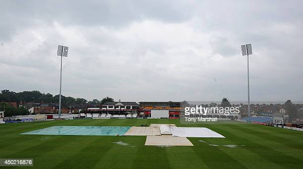 A view of the County ground at Northampton with the covers on and flooding on the out field due to heavy rain during the tour Match between...