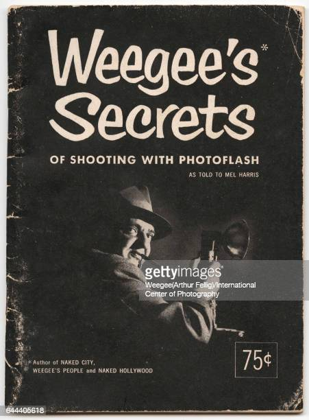 View of the cover of the book 'Weegee's Secrets of Shooting with Photoflash' 1953 The cover features a photo of Weegee a camera in his hands and...