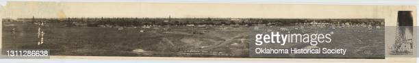 View of the Covington-Garber oil fields, Oklahoma, early 20th century. The text at bottom references that the view is 'a long range photo from the...