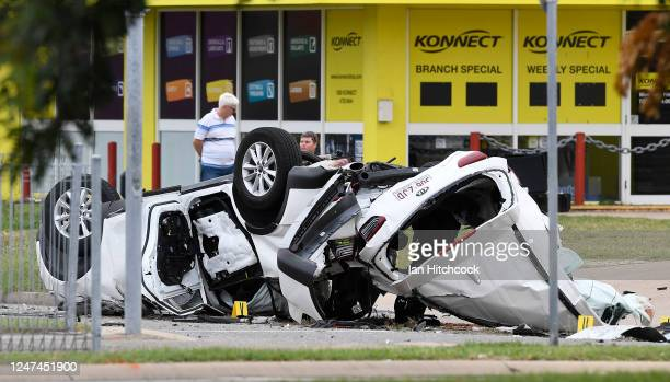 View of the crashed vehicle is seen laying on the road on June 07, 2020 in Townsville, Australia. Four teenagers have been killed in a single-vehicle...