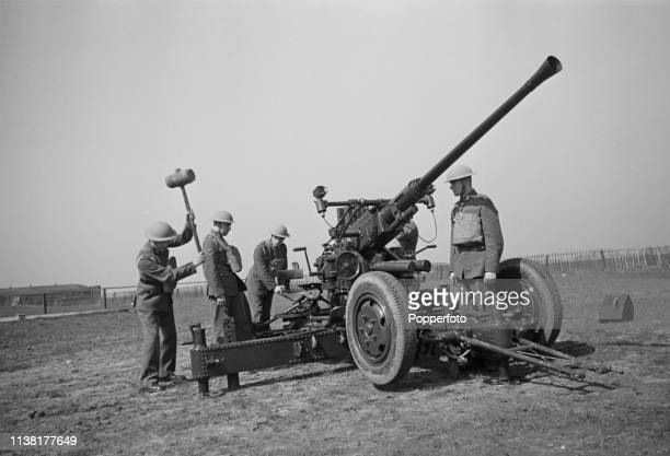 View of the crew of a British Army Bofors 40 mm anti-aircraft gun placing the autocannon in position at Royal Air Force station RAF Biggin Hill near...