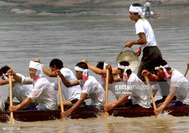 View of the crew of a dragon boat as they row on the Lichang River during a race Yunnan province China April 1980