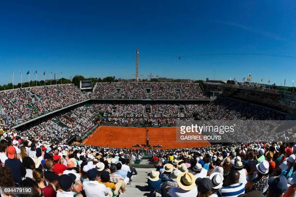 View of the crowd at the central court during the final tennis match opposing Romania's Simona Halep to Latvia's Jelena Ostapenko at the Roland...