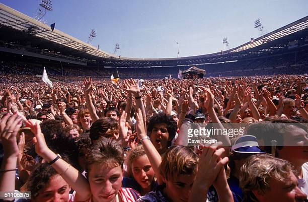 View of the crowd at the Live Aid charity concert, Wembley Stadium, London, 13th July 1985.