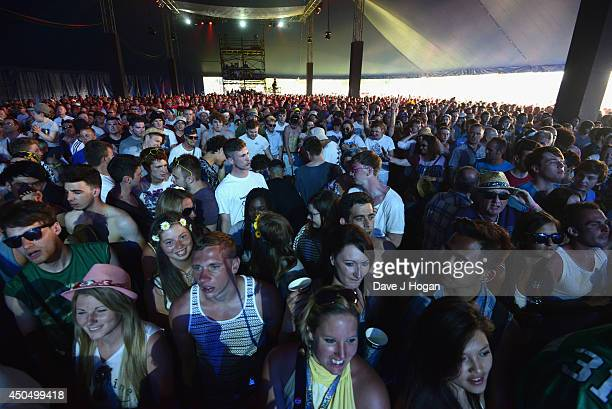 View of the crowd during the performance of 'From the Jam' in the Big Top on the eve of The Isle of Wight Festival at Seaclose Park on June 12 2014...