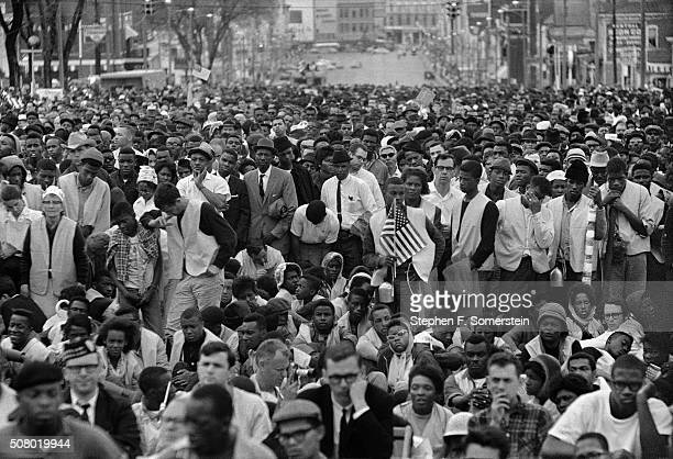 View of the crowd listening to a speech by Dr. Martin Luther King, Jr. During the Selma to Montgomery civil rights March on March 25, 1965 in...