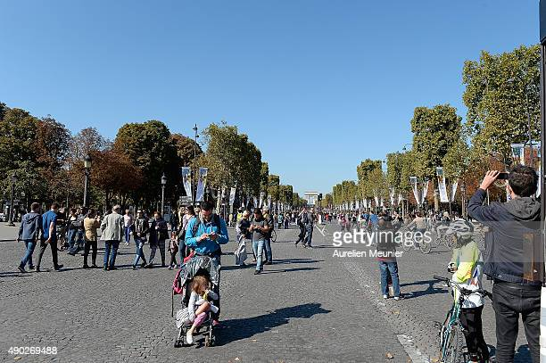 A view of the crowd on the Champs Elysees with the Arc de Triomphe on the background during the car free day on September 27 2015 in Paris France...