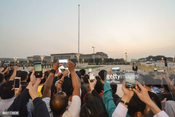 A view of the crowd watching the lowering of the National Flag Ceremony at Tiananmen Square in Beijing just days ahead of the upcoming National Day...