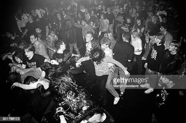 View of the crowd while Napalm Death perform on stage at the ICA, London, United Kingdom, 1990.