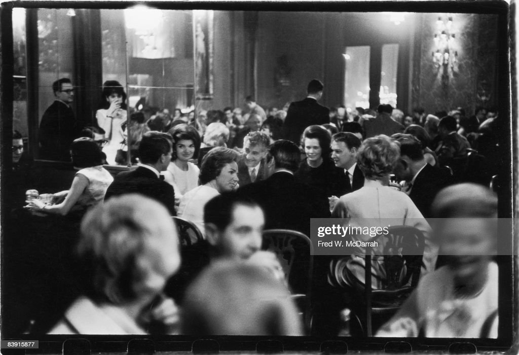 View of the crowded dining room at the Metropolitan Opera House, New York, New York, April 1965. Attending a performance of the Royal Ballet, and seated around the center table are United States Senator (and former US Attorney General) Robert F. Kennedy (1925 - 1968), Jackie Kennedy (1929 - 1994), composer and conductor Leonard Bernstein (1918 - 1990), Margo Nichols and her husband, film director and comedian Mike Nichols, Ethel Kennedy, and actor (and Kennedy in-law) Peter Lawford (1923 - 1984).