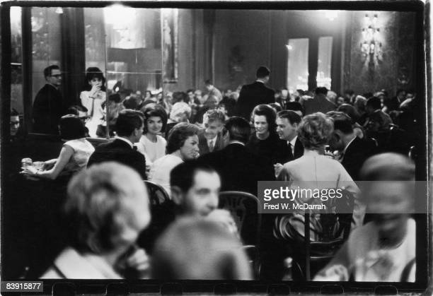 View of the crowded dining room at the Metropolitan Opera House New York New York April 1965 Attending a performance of the Royal Ballet and seated...