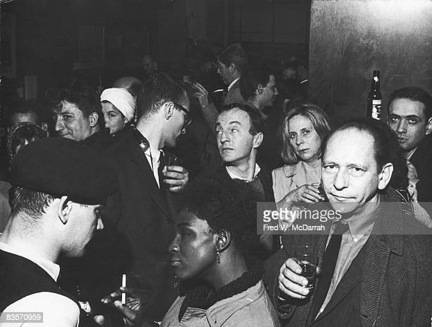 View of the crowded interior of the Cedar Street Tavern on its closing night New York New York March 30 1963 Among those visible are American poets...
