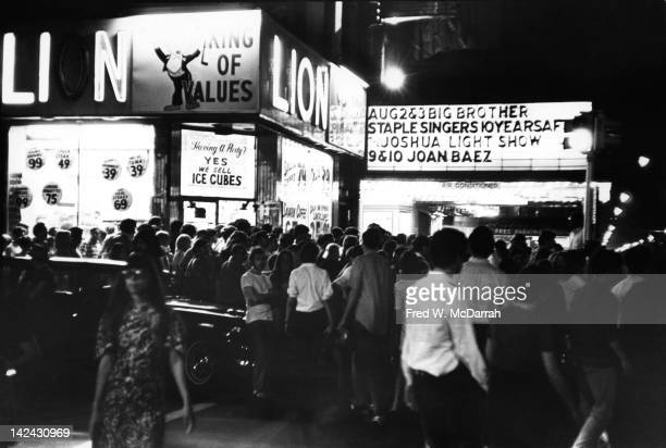 View of the crowded sidewalk outside the Fillmore East for a performance by Big Brother the Holding Company with Janis Joplin New York New York...