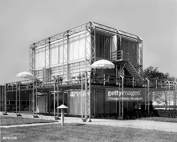 View of the 'Crystal House' at the Century of Progress International Exposition Chicago Illinois 1934 The home's exterior frame and glass walls were...