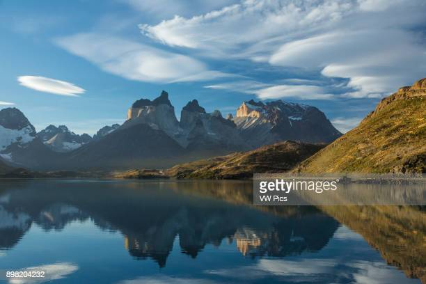 View of the Cuernos del Paine and Monte Almirante Nieto at sunset with Lake Pehoe in the foreground with reflections of the peaks To the left is the...