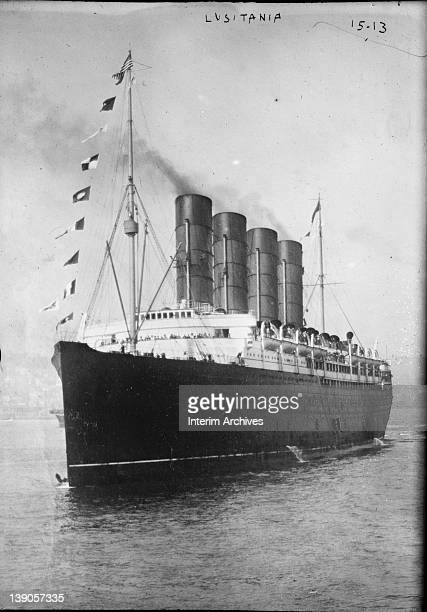 View of the Cunard Line's RMS Lusitania bow and portside in the harbor early twentieth century The ship is probably arriving into the harbor of New...