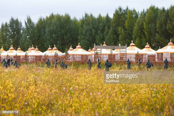 A view of the Dahan Palace one of Genghis Khan residences with armored soldiers horses and temples located along 244 Provincial Rd near Damaquan...