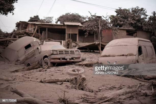 TOPSHOT View of the damage casued by the eruption of the Fuego Volcano in San Miguel Los Lotes a village in Escuintla Department about 35 km...