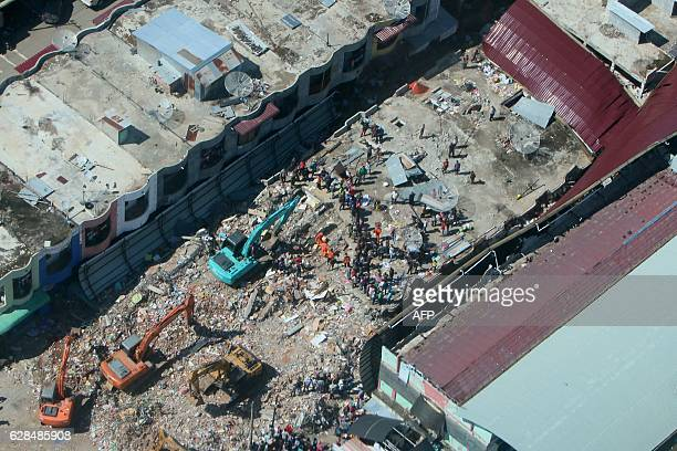 A view of the damage caused after an earthquake in Pidie Jaya on December 8 2016 Aftershocks rattled the survivors of a devastating Indonesian...