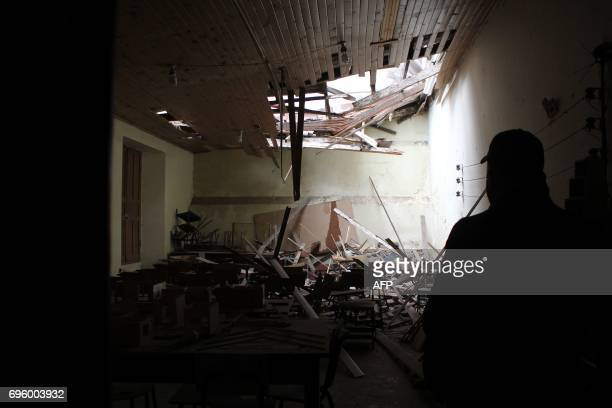 View of the damage caused on a school by an earthquake in Quetzaltenango 220 km from Guatemala City on June 14 2017 A strong 69 magnitude earthquake...