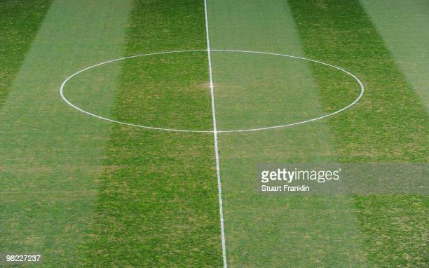 A view of the damaged pitch and worn grass at the Veltins Arena before the start of the Bundesliga match between FC Schalke 04 and FC Bayern Muenchen...