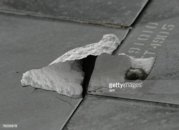 View of the damaged tiles on the underbelly of the space shuttle Endeavour following landing 21 August 2007 at Kennedy Space Center in Cape Canaveral...