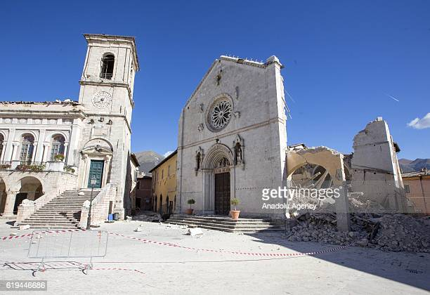 View of the damaged town hall, on left, and the collapsed St. Benedict Basilica, after the earthquake that hit central Italy, in Norcia, Italy, on...