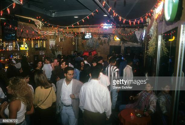 View of the dancing and merriment during a New Year's party held inside New York City's Webster Hall, 1993.