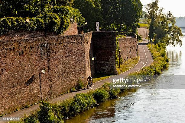 View of the Danube bankside and the city walls from the Gänstorbrücke, Ulm, Germany