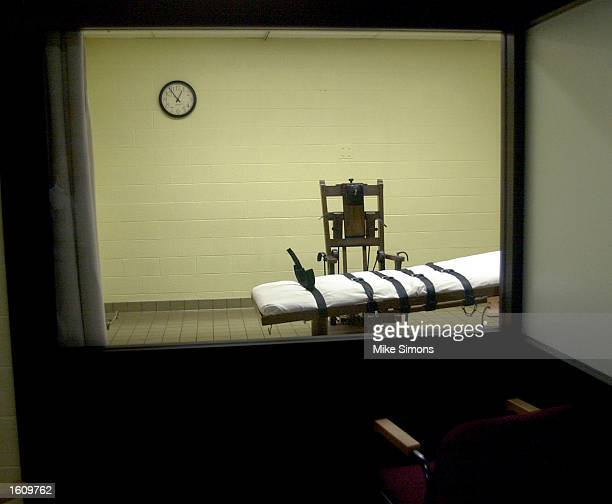 View of the death chamber from the witness room at the Southern Ohio Correctional Facility shows an electric chair and gurney August 29, 2001 in...