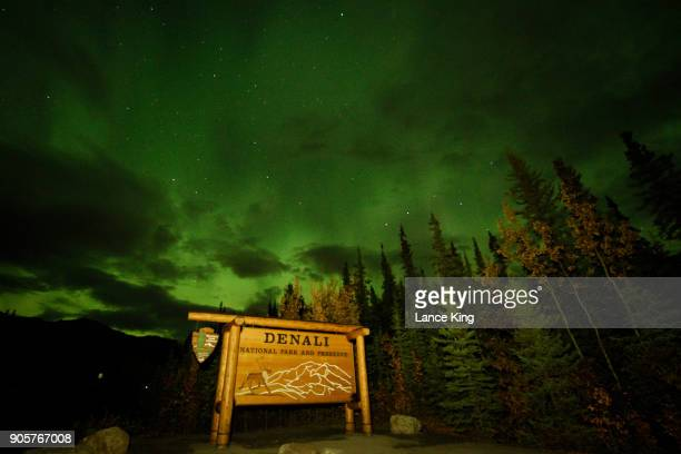 A view of the Denali National Park and Preserve entrance sign as the Aurora Borealis appears in the sky on September 17 2017 in Denali National Park...