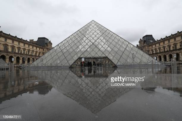 A view of the deserted court yard outside the closed Pyramid the main entrance to the Louvre museum which was once a royal residence located in...