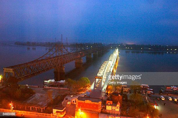 A view of the deserted No Name Bridge on the Yalu River which usually serves for freight transport at night beside the Sino Korea Friendship bridge...