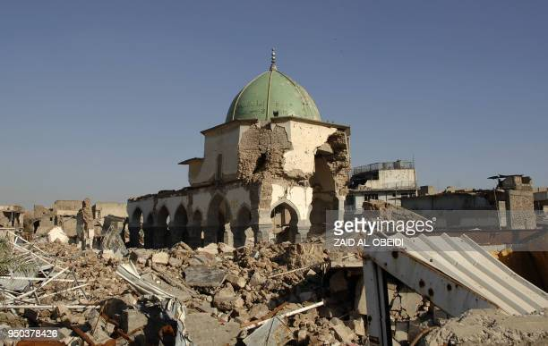 A view of the destroyed alNuri mosque in the old city of Mosul is seen on April 23 2018 The United Arab Emirates and Iraq launched a joint effort to...