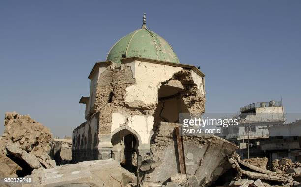 A view of the destroyed alNuri mosque is seen in the old city of Mosul in northern Iraq on April 23 2018 The United Arab Emirates and Iraq launched a...