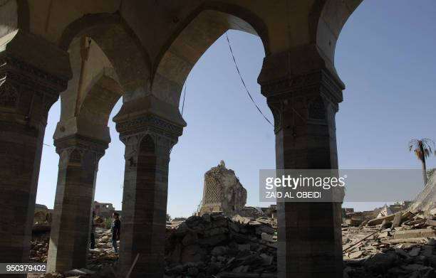 A view of the destroyed leaning minaret dubbed the hunchback or AlHabda at the alNuri mosque is seen in the old city of Mosul in northern Iraq on...